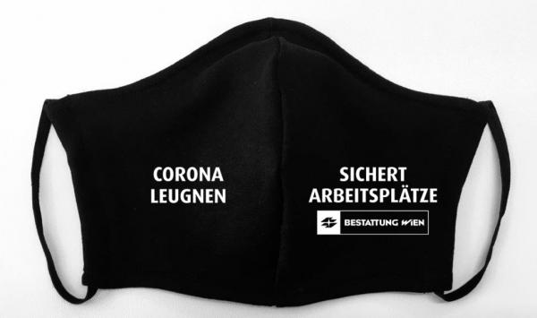 "Mundschutz ""Corona leugnen sichert Arbeitsplätze"" - Bestattung Wien"